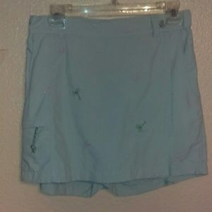 Columbia tan skort with palm trees and flamingos